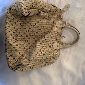 Top handle satchel ivory with navy monogram.